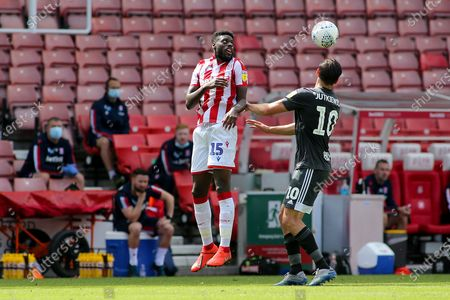 Bruno Martins Indi of Stoke City (15) and Lukas Jutkiewicz of Birmingham City (10) battle for the ball during the EFL Sky Bet Championship match between Stoke City and Birmingham City at the Bet365 Stadium, Stoke-on-Trent