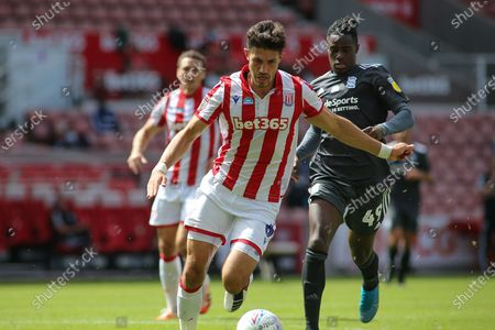 Danny Batth of Stoke City (6) brings the ball out of defence during the EFL Sky Bet Championship match between Stoke City and Birmingham City at the Bet365 Stadium, Stoke-on-Trent