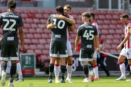 Lukas Jutkiewicz of Birmingham City (10) gets a hug during the EFL Sky Bet Championship match between Stoke City and Birmingham City at the Bet365 Stadium, Stoke-on-Trent
