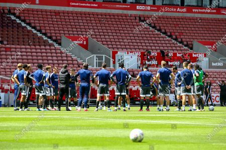 Birmingham City players have a pre match pep talk from Steve Spooner Caretaker Manager of Birmingham City and Craig Gardner Caretaker Manager of Birmingham City City  during the EFL Sky Bet Championship match between Stoke City and Birmingham City at the Bet365 Stadium, Stoke-on-Trent