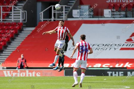 Sam Vokes of Stoke City (9) leaps highest to win a header during the EFL Sky Bet Championship match between Stoke City and Birmingham City at the Bet365 Stadium, Stoke-on-Trent