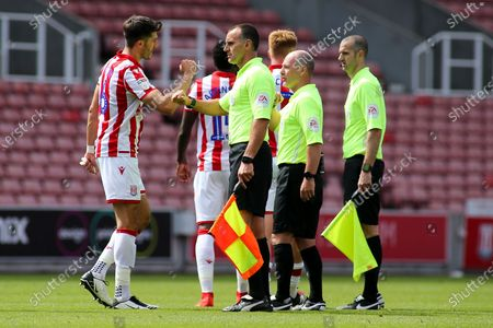 Danny Batth of Stoke City (6) avoids shaking hans with the match officials during the EFL Sky Bet Championship match between Stoke City and Birmingham City at the Bet365 Stadium, Stoke-on-Trent