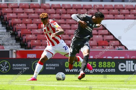 Tyrese Campbell of Stoke City (26) takes on Nico Gordon of Birmingham City (50)  during the EFL Sky Bet Championship match between Stoke City and Birmingham City at the Bet365 Stadium, Stoke-on-Trent