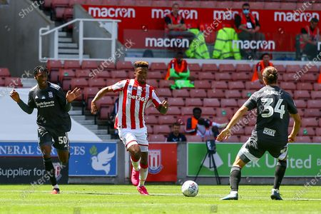 Tyrese Campbell of Stoke City (26) takes on Ivan Sunjic of Birmingham City (34) during the EFL Sky Bet Championship match between Stoke City and Birmingham City at the Bet365 Stadium, Stoke-on-Trent