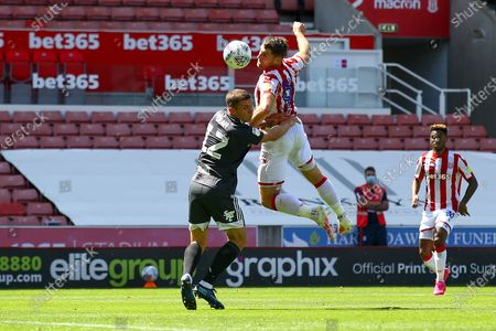 Sam Vokes of Stoke City (9) beats Harlee Dean of Birmingham City (12) to the ball during the EFL Sky Bet Championship match between Stoke City and Birmingham City at the Bet365 Stadium, Stoke-on-Trent