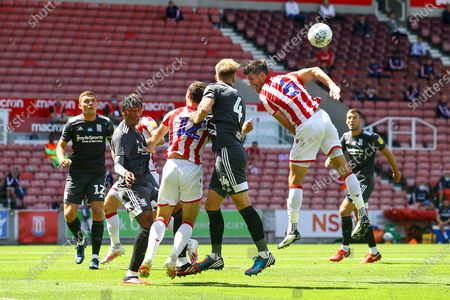 Marc Roberts of Birmingham City (4) just beats Danny Batth of Stoke City (6) to a corner ball during the EFL Sky Bet Championship match between Stoke City and Birmingham City at the Bet365 Stadium, Stoke-on-Trent
