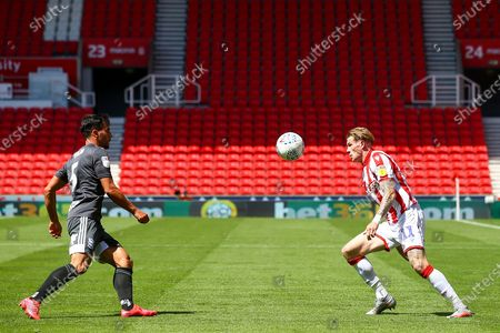 James McClean of Stoke City (11) and Maxime Colin of Birmingham City (5) during the EFL Sky Bet Championship match between Stoke City and Birmingham City at the Bet365 Stadium, Stoke-on-Trent