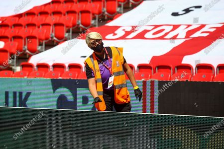A steward making sure the balls are sanitised during the EFL Sky Bet Championship match between Stoke City and Birmingham City at the Bet365 Stadium, Stoke-on-Trent