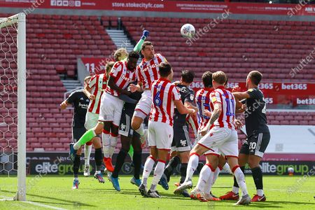 Adam Davies of Stoke City (16) punches the ball clear during the EFL Sky Bet Championship match between Stoke City and Birmingham City at the Bet365 Stadium, Stoke-on-Trent