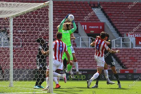 Adam Davies of Stoke City (16) is put under pressure at a corner kick during the EFL Sky Bet Championship match between Stoke City and Birmingham City at the Bet365 Stadium, Stoke-on-Trent