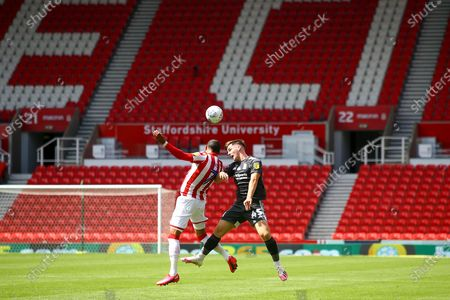 Thomas Ince of Stoke City (7) and Ryan Burke of Birmingham City (45) battle for a header during the EFL Sky Bet Championship match between Stoke City and Birmingham City at the Bet365 Stadium, Stoke-on-Trent