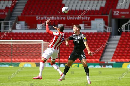Thomas Ince of Stoke City (7) and Ryan Burke of Birmingham City (45) battle for the ball during the EFL Sky Bet Championship match between Stoke City and Birmingham City at the Bet365 Stadium, Stoke-on-Trent