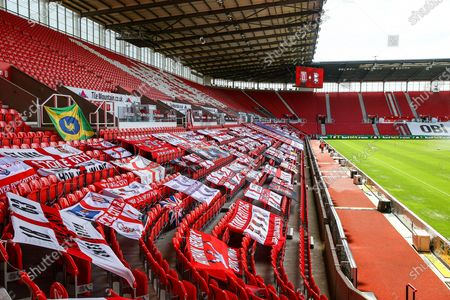 Stoke fans place flags on the empty seating during the EFL Sky Bet Championship match between Stoke City and Birmingham City at the Bet365 Stadium, Stoke-on-Trent