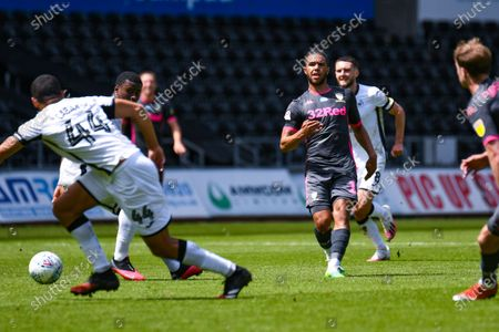 Leeds United forward Tyler Roberts (11) passes the ball during the EFL Sky Bet Championship match between Swansea City and Leeds United at the Liberty Stadium, Swansea