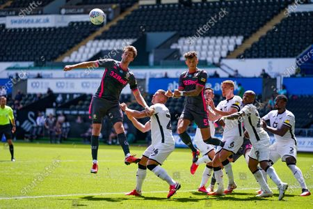 Leeds United forward Patrick Bamford (9) and Leeds United defender Ben White (5) during the EFL Sky Bet Championship match between Swansea City and Leeds United at the Liberty Stadium, Swansea