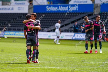 Leeds United midfielder Pablo Hernandez (19) is hugged by Leeds United defender Gaetano Berardi (28) during the EFL Sky Bet Championship match between Swansea City and Leeds United at the Liberty Stadium, Swansea