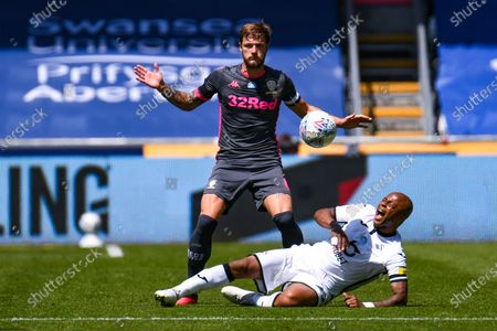 Leeds United defender Liam Cooper (6) and Swansea City forward Andre Ayew (22) during the EFL Sky Bet Championship match between Swansea City and Leeds United at the Liberty Stadium, Swansea
