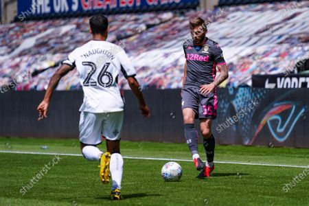 Leeds United defender Stuart Dallas (15) during the EFL Sky Bet Championship match between Swansea City and Leeds United at the Liberty Stadium, Swansea