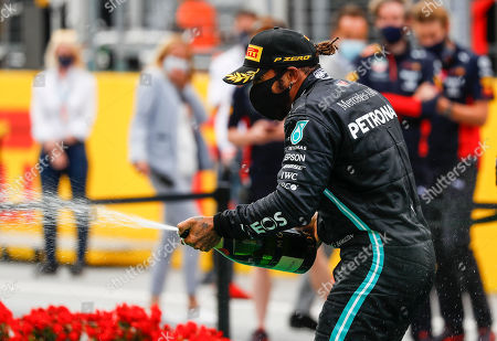 Mercedes driver Lewis Hamilton of Britain celebrates with champagne after winning the Styrian Formula One Grand Prix race at the Red Bull Ring racetrack in Spielberg, Austria, Sunday, July 12, 2020. (Leonhard Foeger/Pool via AP)