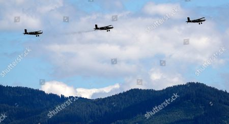 Planes flying over the track prior the Styrian Formula One Grand Prix race at the Red Bull Ring racetrack in Spielberg, Austria, Sunday, July 12, 2020. (Leonhard Foeger/Pool via AP)