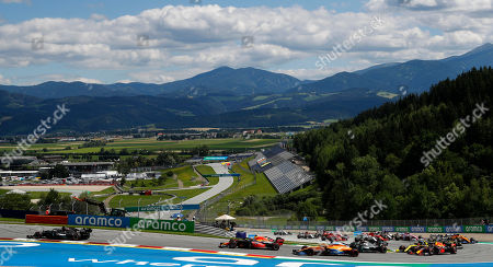 Mercedes driver Lewis Hamilton of Britain, left, leads during the Styrian Formula One Grand Prix race at the Red Bull Ring racetrack in Spielberg, Austria, Sunday, July 12, 2020. (Leonhard Foeger/Pool via AP)