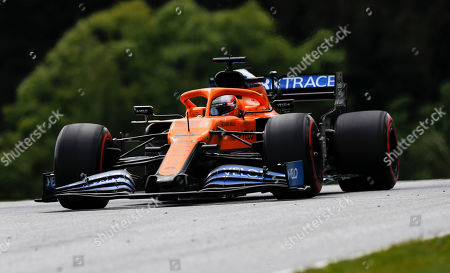 Mclaren driver Carlos Sainz of Spain steers his car during the Styrian Formula One Grand Prix race at the Red Bull Ring racetrack in Spielberg, Austria, Sunday, July 12, 2020. (Leonhard Foeger/Pool via AP)