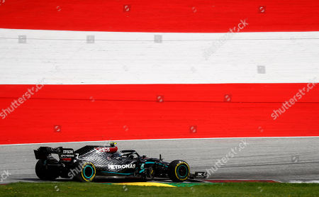 Mercedes driver Valtteri Bottas of Finland steers his car during the Styrian Formula One Grand Prix race at the Red Bull Ring racetrack in Spielberg, Austria, Sunday, July 12, 2020. (Leonhard Foeger/Pool via AP)