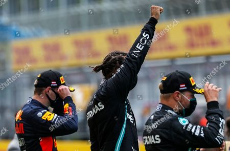 Mercedes driver Lewis Hamilton of Britain, center, reacts on the podium after winning the Styrian Formula One Grand Prix race at the Red Bull Ring racetrack in Spielberg, Austria, Sunday, July 12, 2020. Third placed Red Bull driver Max Verstappen of the Netherlands on the left, second placed Mercedes driver Valtteri Bottas of Finland on the right. (Leonhard Foeger/Pool via AP)