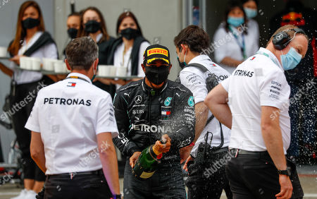 Mercedes driver Lewis Hamilton of Britain celebrates witch champagne after winning the Styrian Formula One Grand Prix race at the Red Bull Ring racetrack in Spielberg, Austria, Sunday, July 12, 2020. (Leonhard Foeger/Pool via AP)