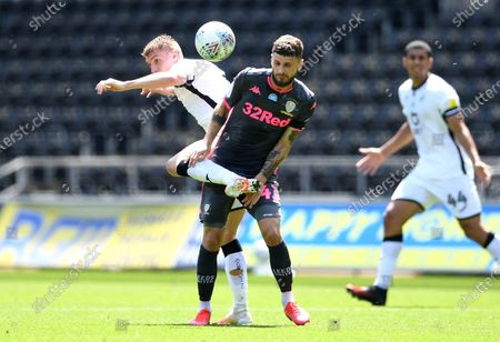 Mateusz Klich of Leeds United is tackled by Jay Fulton of Swansea City.