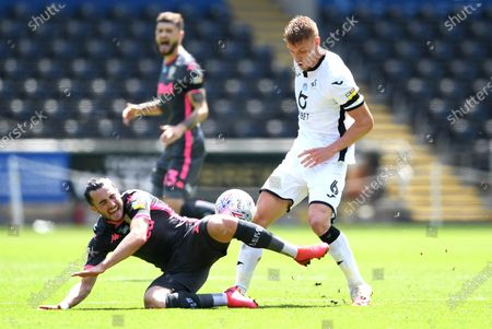 Jack Harrison of Leeds United is tackled by Jay Fulton of Swansea City.
