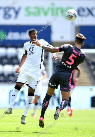 Rhian Brewster of Swansea City is tackled by Ben White of Leeds United.