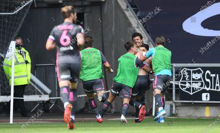 Leeds players celebrate Pablo Hernandez goal.