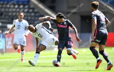 Andre Ayew of Swansea City is tackled by Helder Costa of Leeds United.