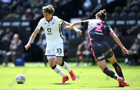 Conor Gallagher of Swansea City tries to go around Luke Ayling of Leeds United.