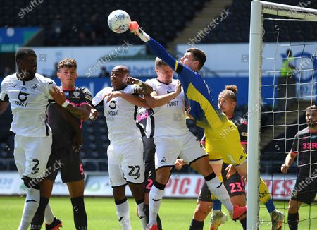 Illan Meslier of Leeds United punches the ball away.