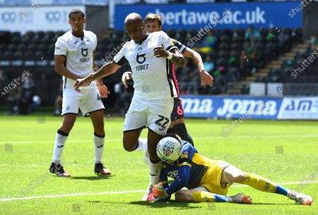Andre Ayew of Swansea City goes for the ball and Illan Meslier of Leeds United pounces.
