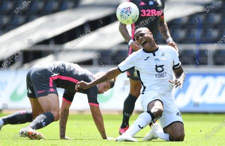 Andre Ayew of Swansea City is tackled by Kalvin Phillips of Leeds United.