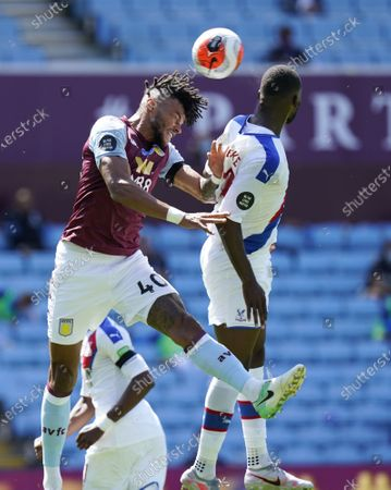 Tyrone Mings (L) of Aston Villa in action against Christian Benteke (R) of Crystal Palace during the English Premier League soccer match between Aston Villa and Crystal Palace in Birmingham, Britain, 12 July 2020.