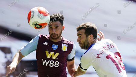Trezeguet (L) of Aston Villa in action against James McArthur (R) of Crystal Palace during the English Premier League soccer match between Aston Villa and Crystal Palace in Birmingham, Britain, 12 July 2020.