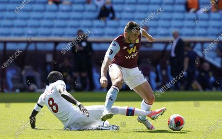 John McGinn (R) of Aston Villa in action against Cheikhou Kouyate (L) of Crystal Palace during the English Premier League soccer match between Aston Villa and Crystal Palace in Birmingham, Britain, 12 July 2020.