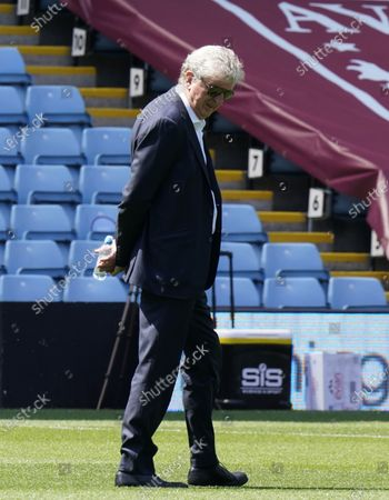 Crystal Palace's manager Roy Hodgson inspects the pitch ahead of the English Premier League soccer match between Aston Villa and Crystal Palace in Birmingham, Britain, 12 July 2020.