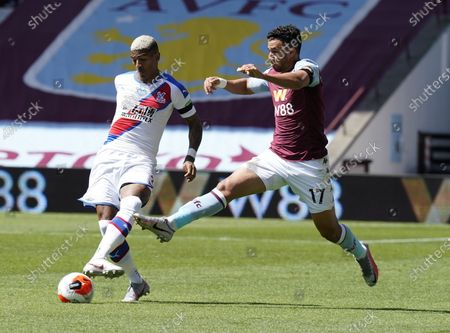 Trezeguet (R) of Aston Villa in action against Patrick van Aanholt (L) of Crystal Palace during the English Premier League soccer match between Aston Villa and Crystal Palace in Birmingham, Britain, 12 July 2020.