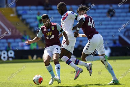 Neil Taylor (L) of Aston Villa in action against Christian Benteke (C) of Crystal Palace during the English Premier League soccer match between Aston Villa and Crystal Palace in Birmingham, Britain, 12 July 2020.
