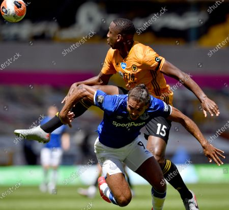 Wolverhampton Wanderers' Willy Boly (up) in action against Everton's Dominic Calvert-Lewin (bottom) during the English Premier League soccer match between Wolverhampton Wanderers and Everton FC in Wolverhampton, Britain, 12 July 2020.