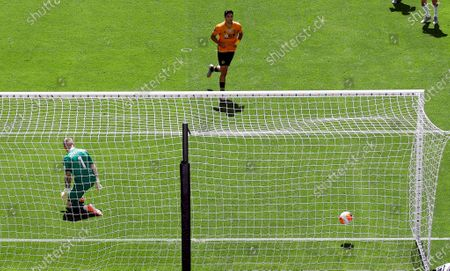 Wolverhampton Wanderers' Raul Jimenez (back) scores the 1-0 lead from the penalty spot during the English Premier League soccer match between Wolverhampton Wanderers and Everton FC in Wolverhampton, Britain, 12 July 2020.