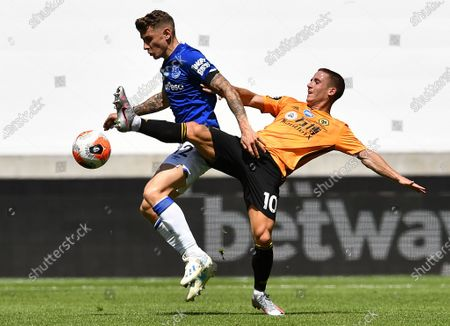 Everton's Lucas Digne (L) in action against Wolverhampton Wanderers' Daniel Podence (R) during the English Premier League soccer match between Wolverhampton Wanderers and Everton FC in Wolverhampton, Britain, 12 July 2020.