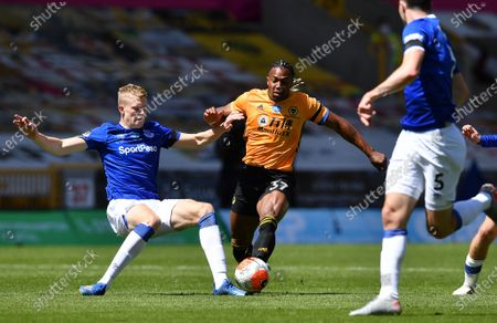 Wolverhampton Wanderers' Adama Traore (C) in action against Everton's Seamus Coleman (L) during the English Premier League soccer match between Wolverhampton Wanderers and Everton FC in Wolverhampton, Britain, 12 July 2020.