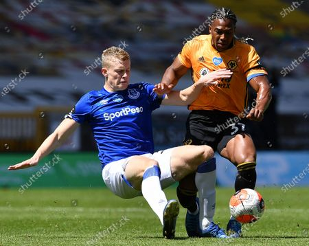 Wolverhampton Wanderers' Adama Traore (R) in action against Everton's Seamus Coleman (L) during the English Premier League soccer match between Wolverhampton Wanderers and Everton FC in Wolverhampton, Britain, 12 July 2020.