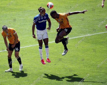 Everton's Dominic Calvert-Lewin (C) in action against Wolverhampton Wanderers' Willy Boly (R) during the English Premier League soccer match between Wolverhampton Wanderers and Everton FC in Wolverhampton, Britain, 12 July 2020.